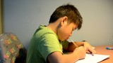 a chinese child doing his homework