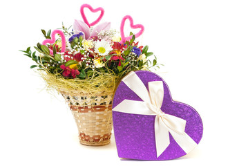 Magnificent bouquet and heart present box on a white background