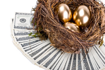Three golden eggs in the nest. A symbol of making money and succ