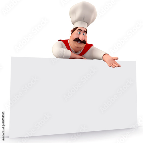 Smiling chef pointing towards sign