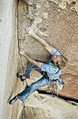 Rock climber struggelling