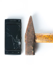 Hammer smashing smart phone