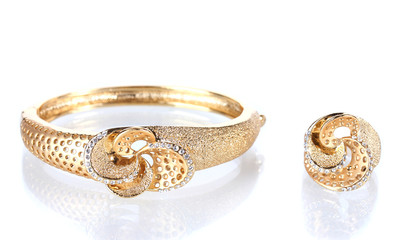 Beautiful golden bracelet and ring with precious stones isolated