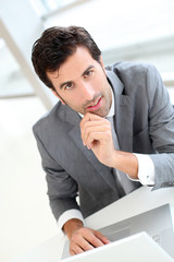 Portrait of confident businessman in meeting