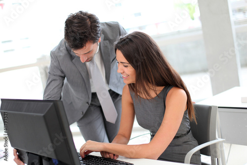Business people in office working on desktop computer