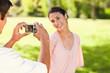 Man takes a photo of his smilng friend