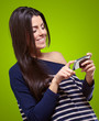 portrait of young woman touching a modern mobile over green