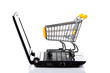 Shopping cart with notebook on the white.