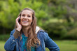 Teenage girl using her mobile phone while showing a great smile