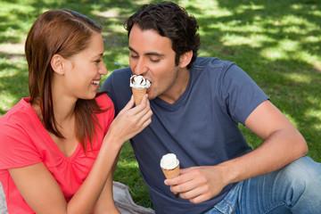 Woman feeding her friend ice cream
