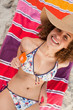 Overhead view of an attractive woman in bikini holding an orange