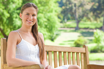 Smiling woman on a park bench