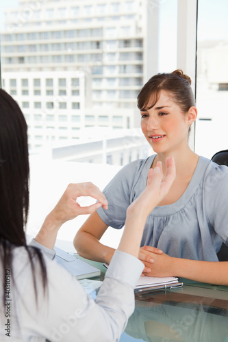 Two business women chat in the office