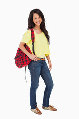 Smiling Latin student posing with a backpack