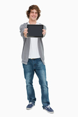 Male student showing a touch pad screen