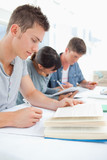 Close up of three students studying hard