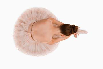 Overhead view of sitting ballerina