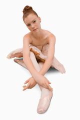 Ballerina sitting on the ground