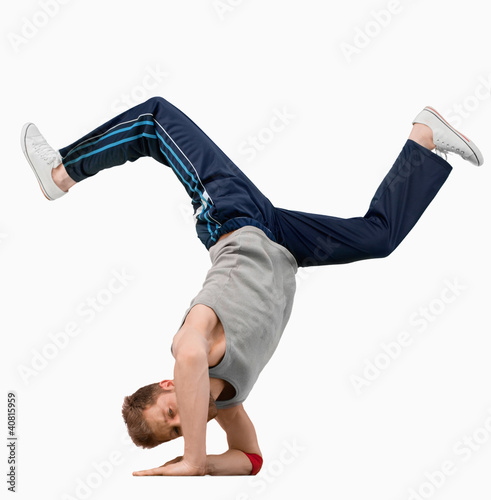 Break dancer doing a hand stand