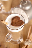 Fototapety coffee latte with cinnamon sticks and cacao heart , shallow dof