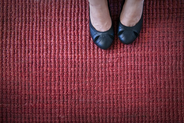 Black Pumps on Red Rug