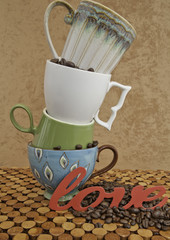 Stacked Coffee Cups on Wooden Counter against Stucco Background