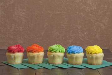 Five Iced Cupcakes Sitting in a Row