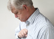 senior man suffers from bad heartburn
