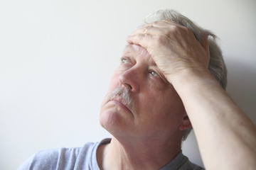 older man with a bad headache