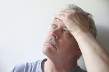 older man with a bad headache