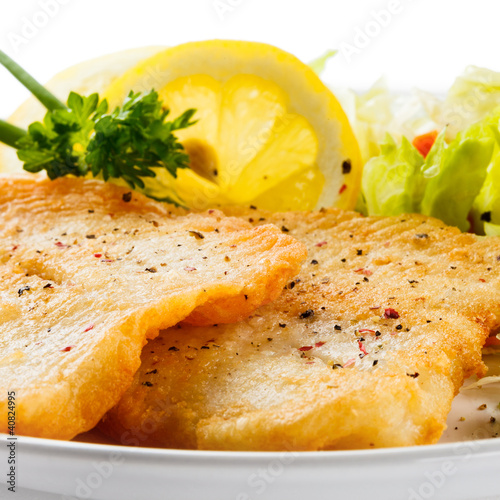 Fish dish - fried fish fillets and vegetable salad