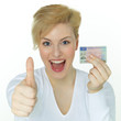 Young woman has thumb up for getting a driver licence