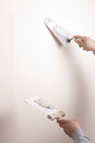 Putty Knife with Paste to Repair Wall Damage poster