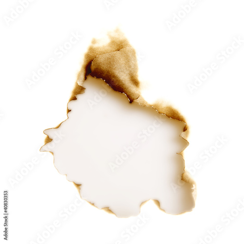 burnt hole in a white sheet of paper