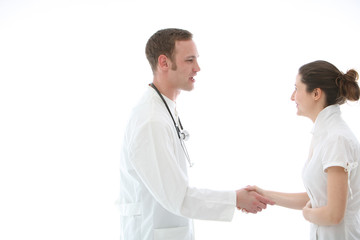 Doctor shaking a colleague's hand in greeting