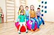 Children sitting on balls