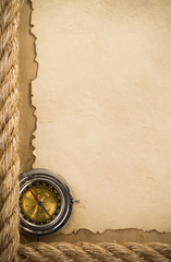 ropes and compass at old paper background
