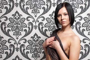Fashion portrait nude elegant woman on vintage wallpaper backgro