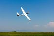Leinwanddruck Bild - Glider flying on a blue sky