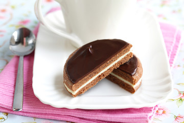 Chocolate sandwich biscuit halved, served with coffee