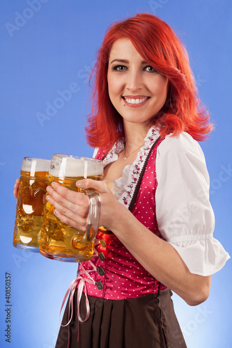 Oktoberfest waitress holding beer