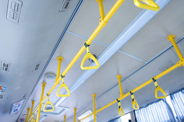 Handles for standing passenger inside a city-bus
