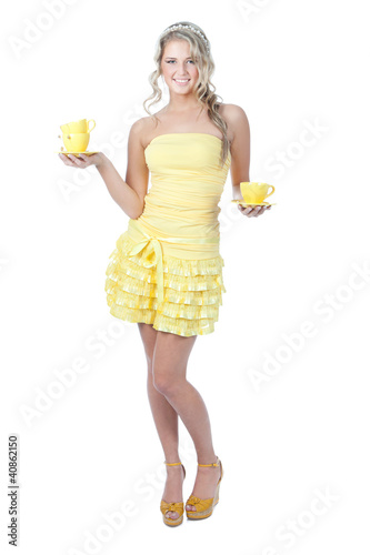 Young happy woman with yellow cups over white