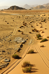 Tyre tracks in the desert landscape of Wadi Rum