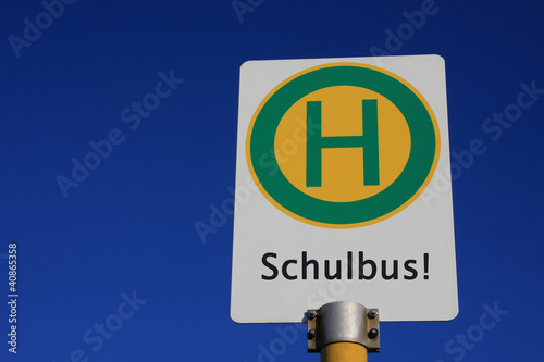 Leinwanddruck Bild Haltestellenschild Schulbus