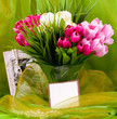 Beautiful spring flowers in a glass vase and frame