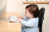 Baby typing on keyboard