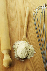 Wheat flour on a wooden spoon