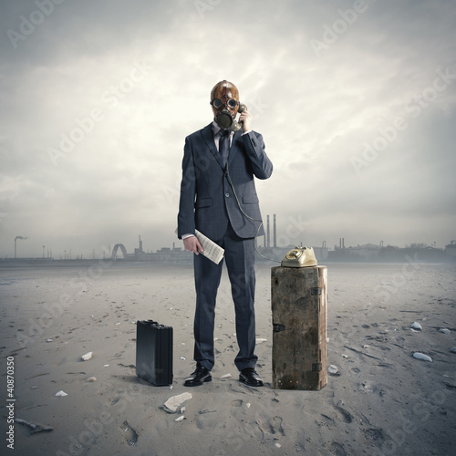 businessman with gasmask at phone