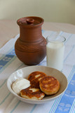 Tasty curd fritters with sour cream and milk